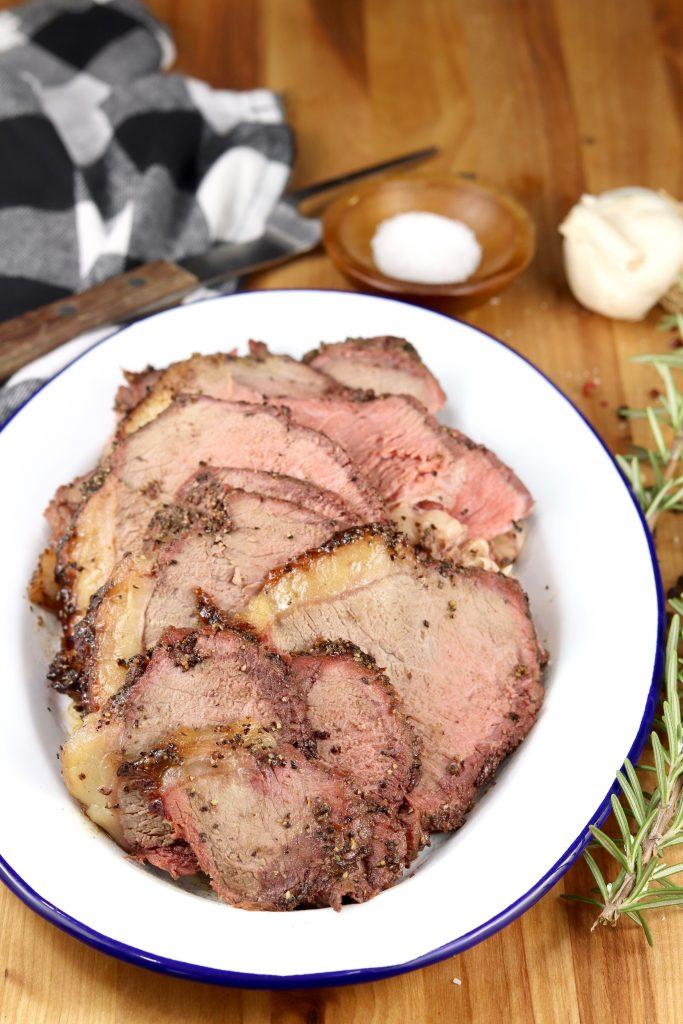 Grilled rump roast sliced on a platter