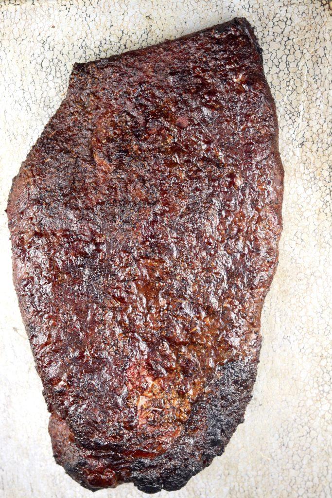 Smoked brisket with brown sugar and garlic rub.