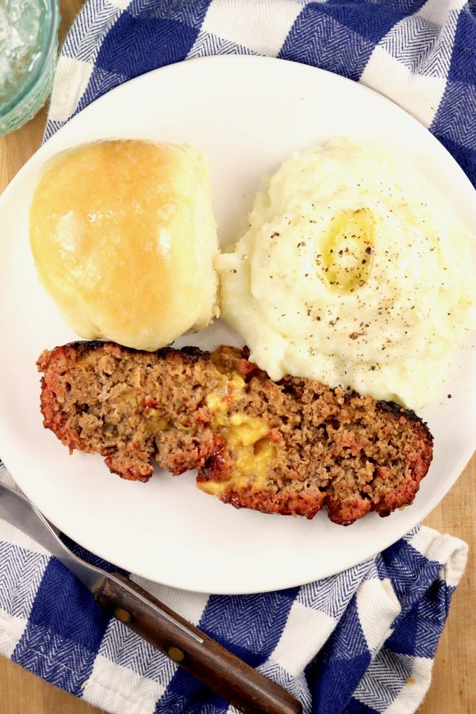 Stuffed Meatloaf with mashed potatoes and homemade roll