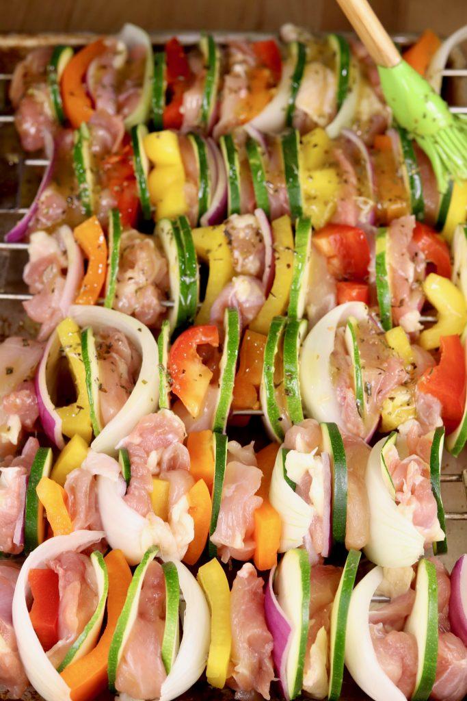 Basting kebabs with marinade