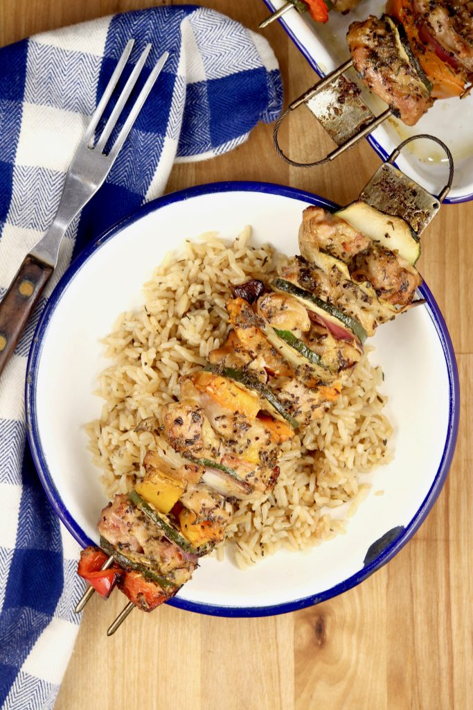 Chicken kebab over rice pilaf