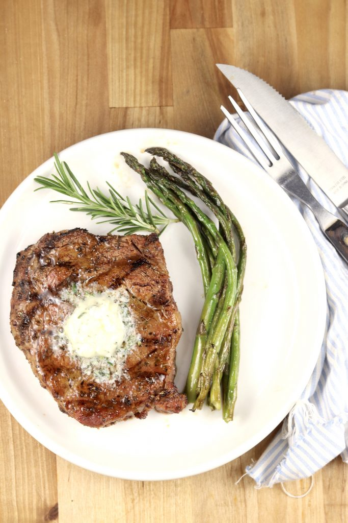 Grilled Garlic Butter Steaks with asparagus