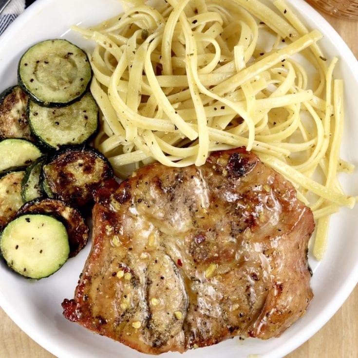 Honey Mustard Pork Steaks with pasta and zucchini