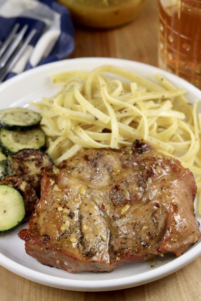 Grilled Honey Mustard Pork Steaks with pasta & zucchini