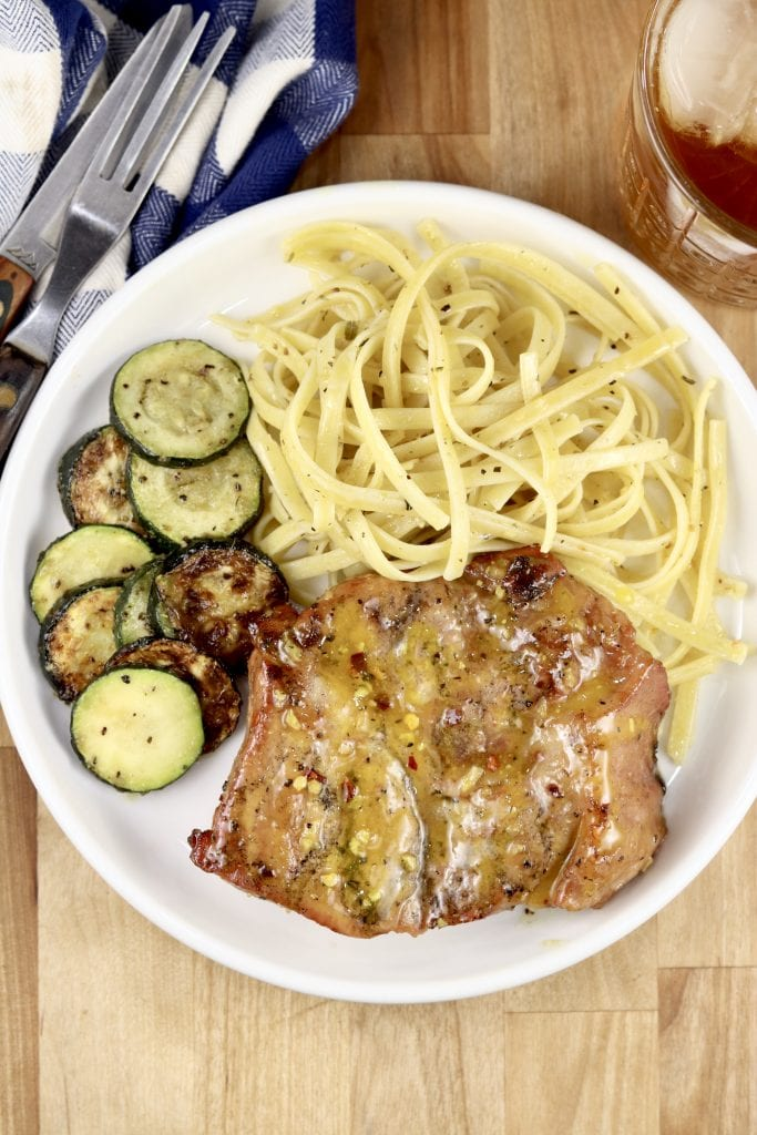 Grilled Honey Mustard Pork Steaks with pasta and zucchini