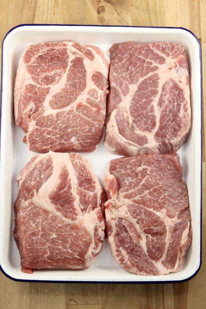 Pork Steaks on a platter for grilling
