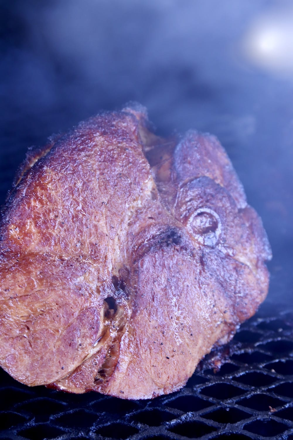 Grilling ham with hickory smoke