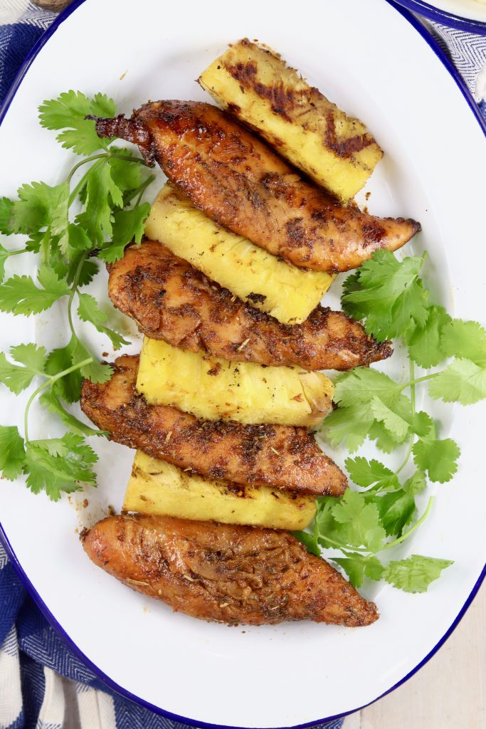 Marinated Grilled Chicken with pineapple wedges on a platter