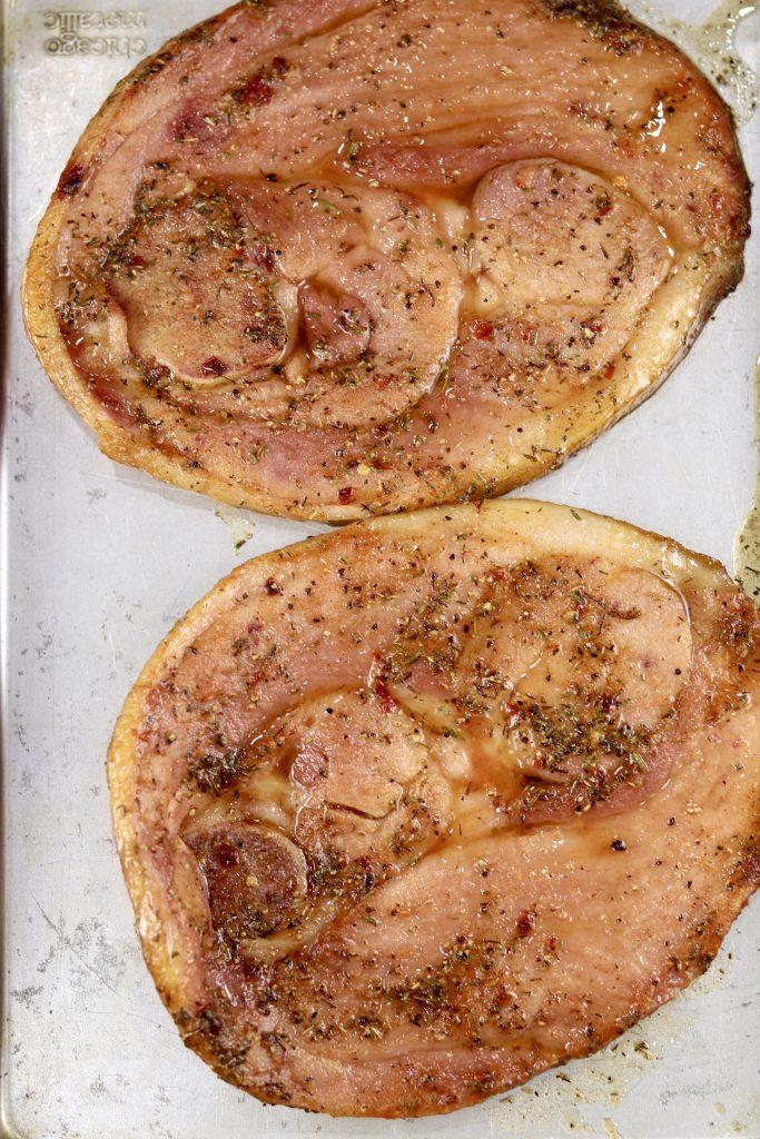 2 Glazed ham steaks on a sheet pan