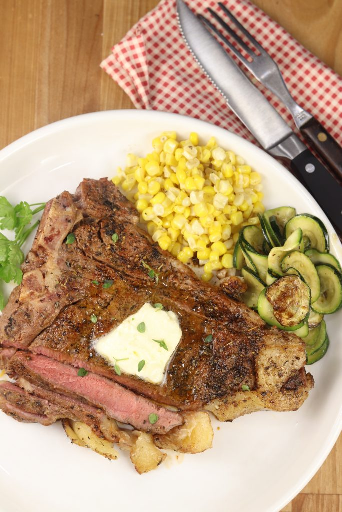 Grilled T-Bone Steak with corn and zucchini