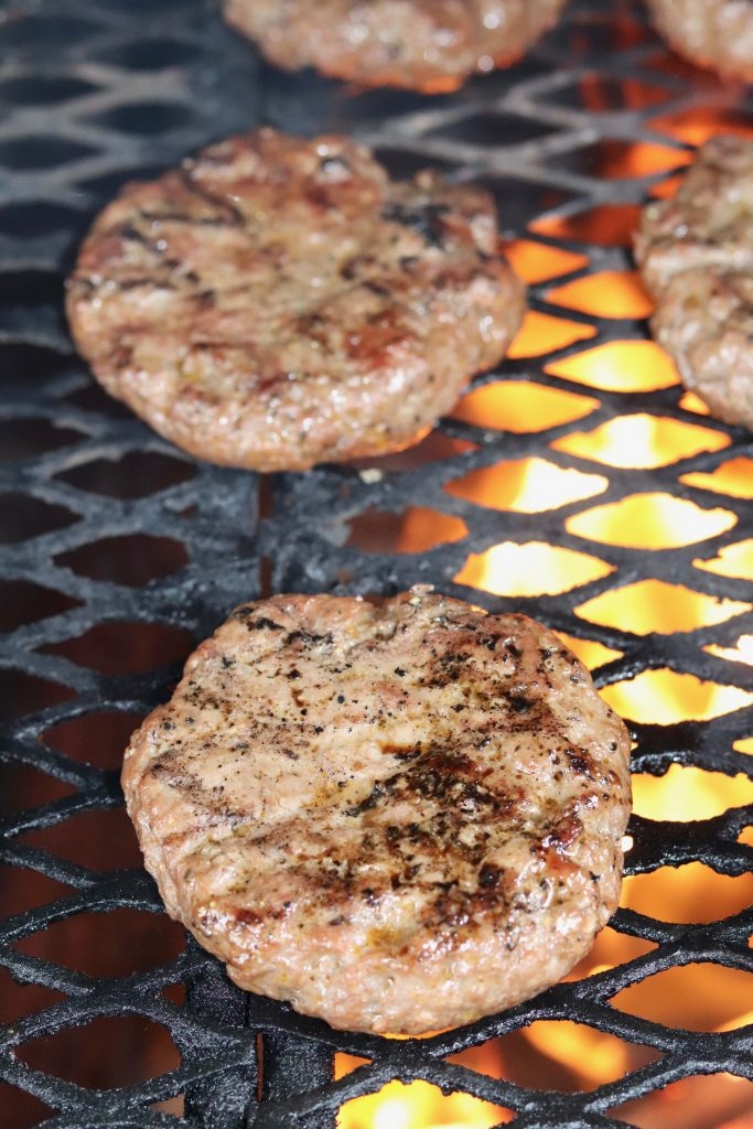 Classic seasoned burgers on the grill