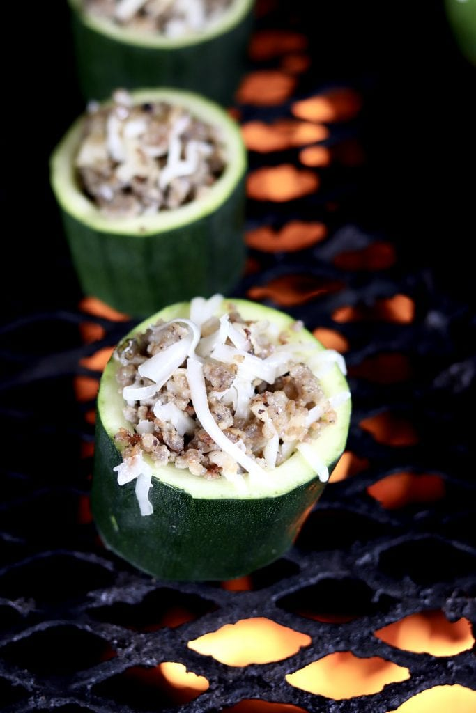 Sausage stuffed zucchini cups on a wood fired grill