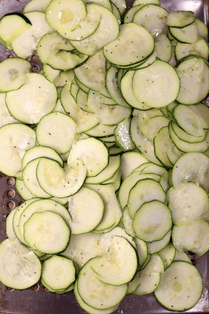 Sliced and seasoned zucchini on a grill pan