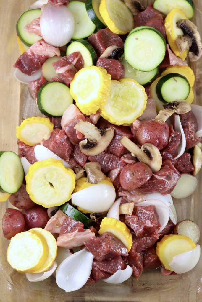 Sliced steak and vegetables for making grilled kabobs