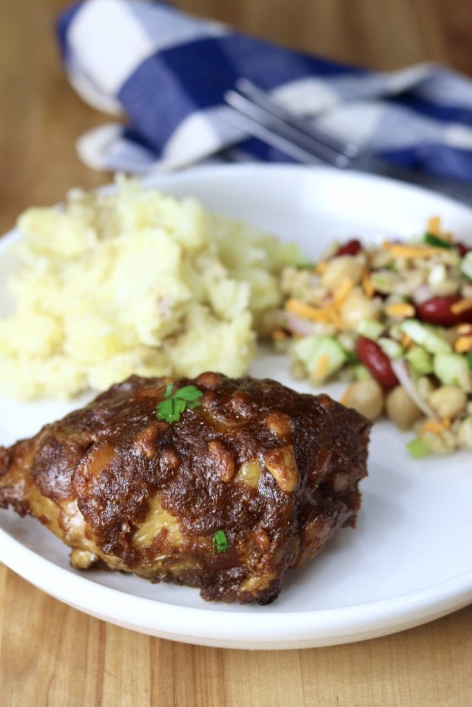 Plate of peanut chicken, mashed potatoes, bean and barley salad