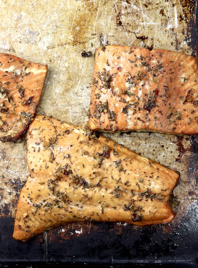 Grilled salmon filets on a sheet pan