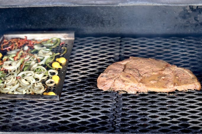 steak and vegetables on the grill for fajitas