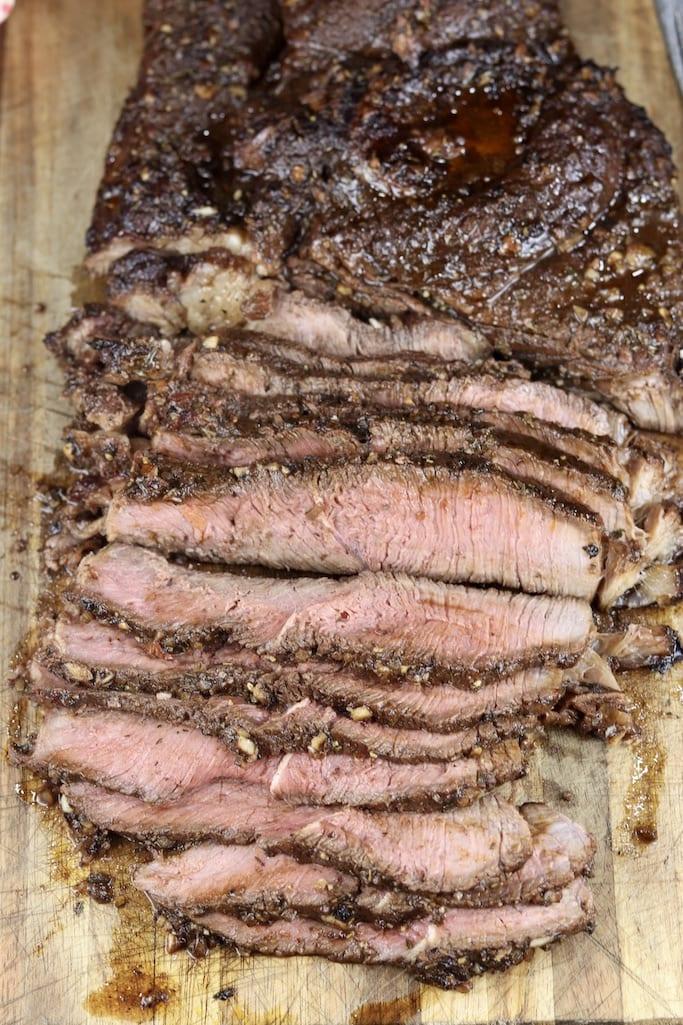 Sliced grilled roast on a cutting board