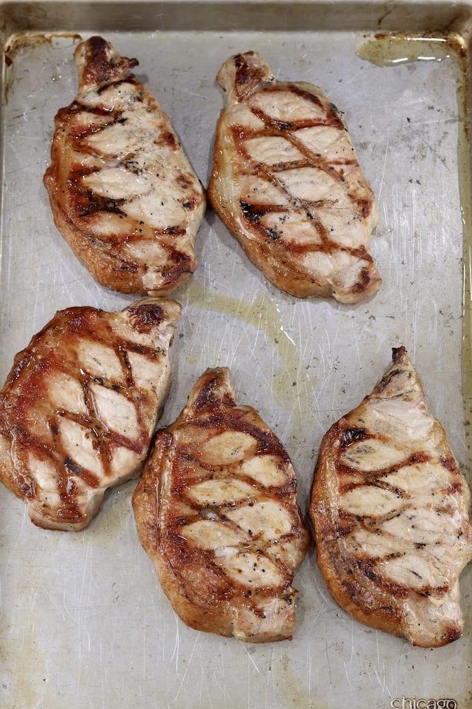 Grilled pork chops on a sheet pan