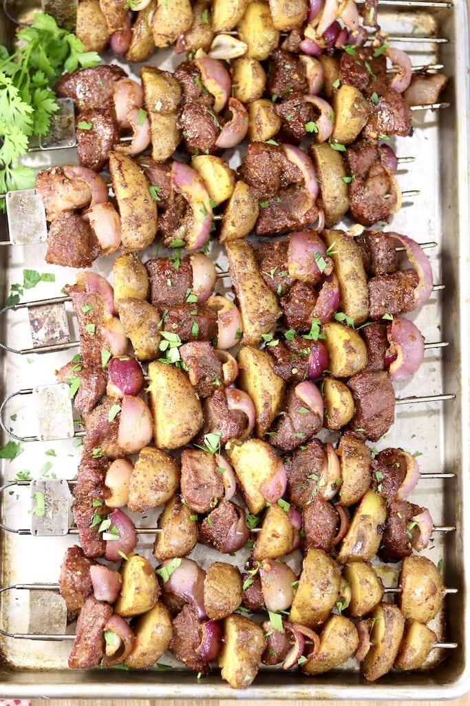 Steak and Potato Kabobs on a sheet pan, parsley garnish