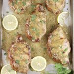 Lemon Garlic Pork Chops with fresh lemon slices and parsley