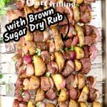 "Text overlay ""Steak & Potato Kabobs"" ""with Brown Sugar Garlic Dry Rub"" kabobs on a sheet pan"