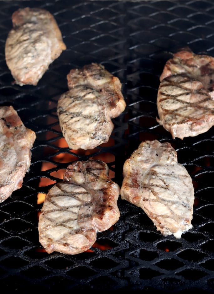 Pork chops on a grill with grill marks