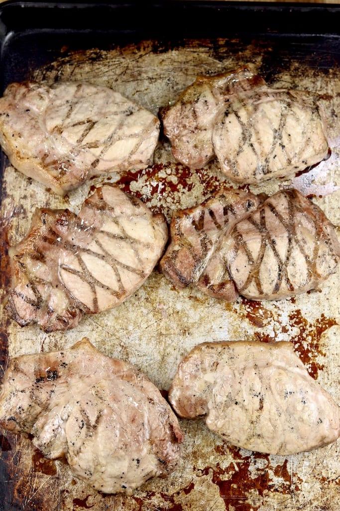 sheet pan of grilled pork chops