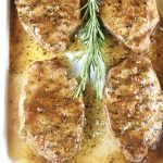 Grilled Orange BBQ Pork Chops garnished with rosemary