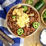 Short Rib Chili with beans, topped with cheese and jalapenos overhead view