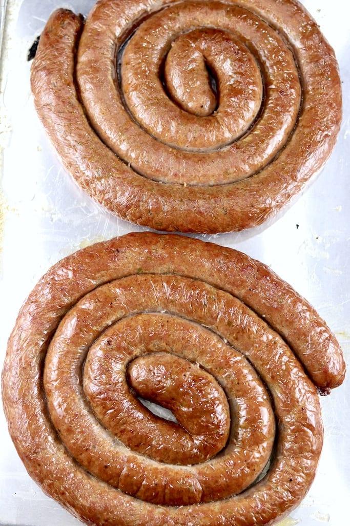 2 spirals of beef smoked sausage on a sheet pan