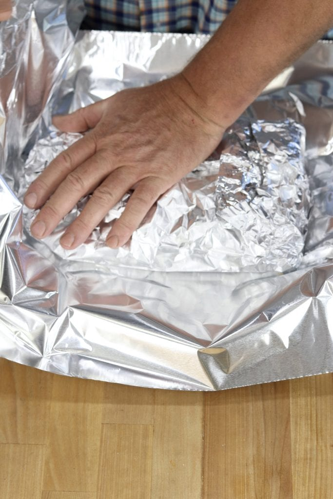 Making a foil packet for shrimp and potatoes