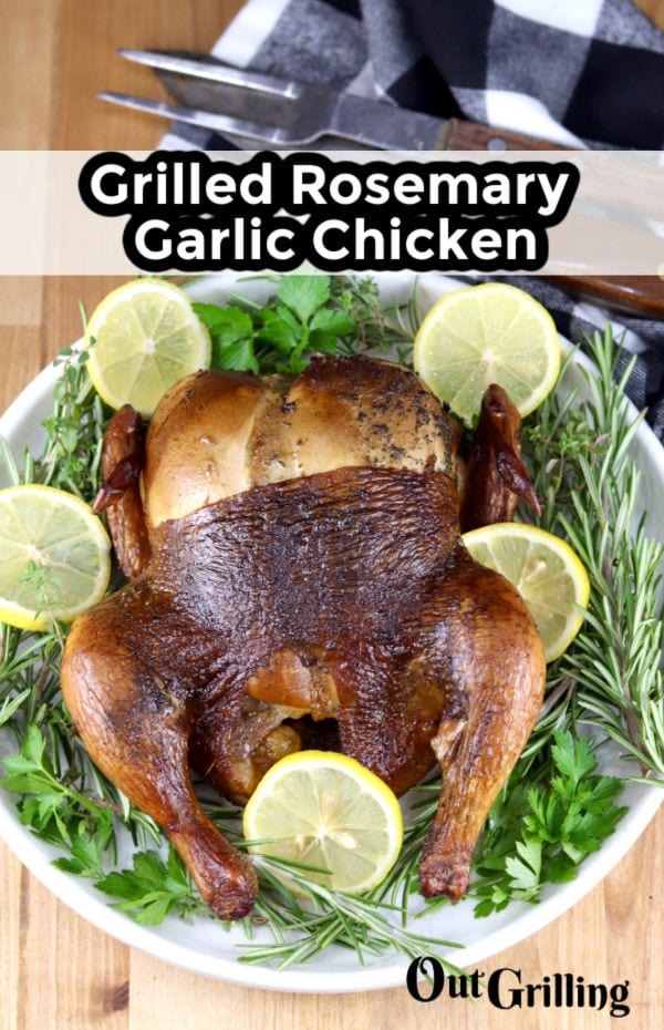 Grilled Rosemary Garlic Chicken on a platter with fresh herbs and lemon slices - text overlay
