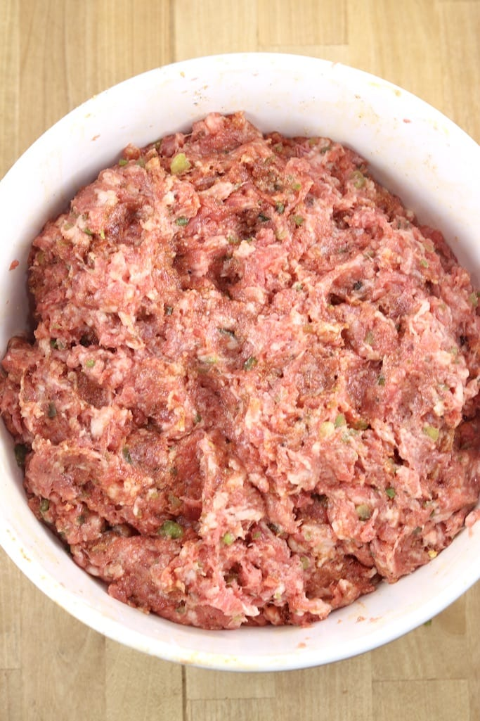 Ground brisket mixture for sausage in a bowl - overhead view