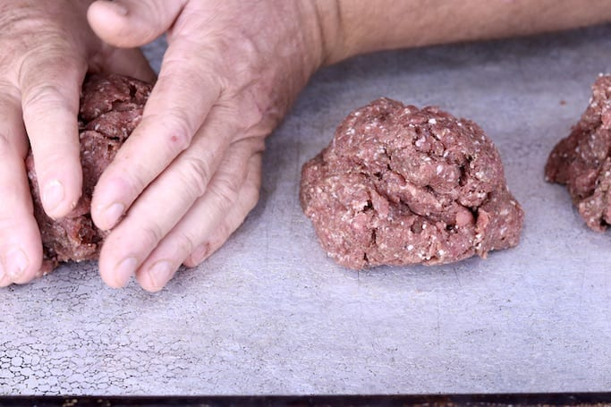 Dividing ground venison into 3 parts