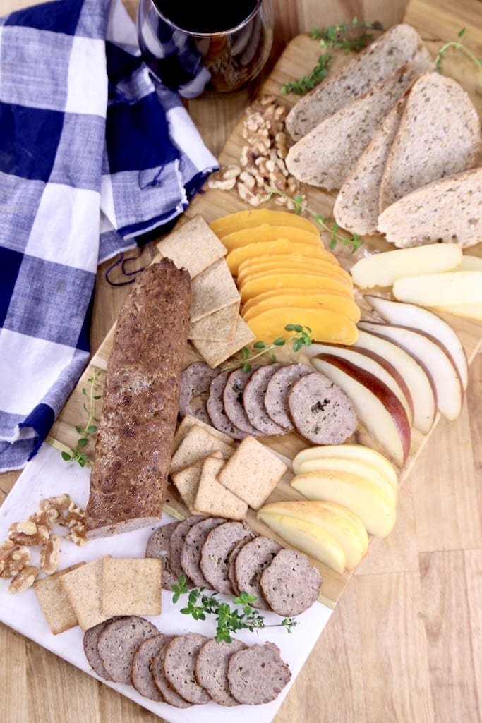 Venison Summer Sausage with cheese and crackers on a board