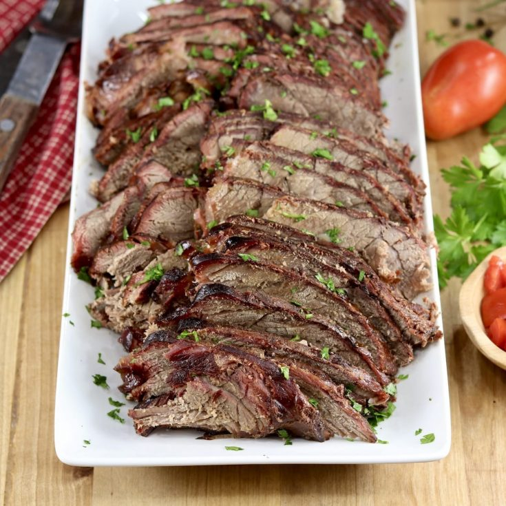 Apple Cider Roast Beef sliced on a platter