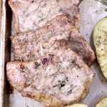 Apple Cider Pork Chops on a sheet pan, close up view