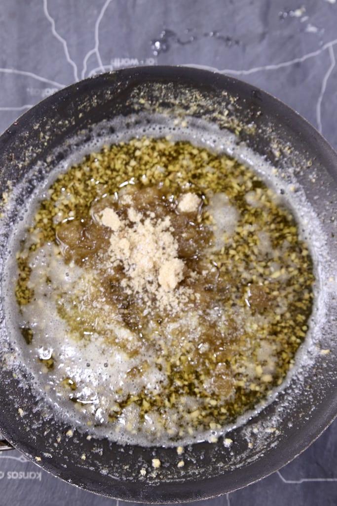 garlic butter with brown sugar in a skillet