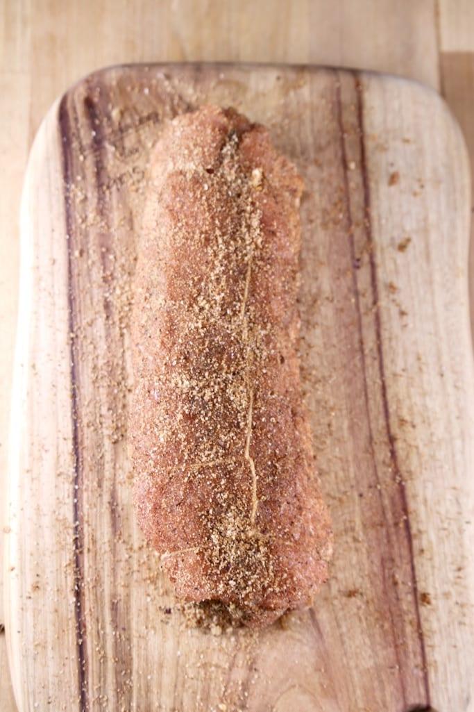 pork tenderloin with brown sugar dry rub on a cutting board