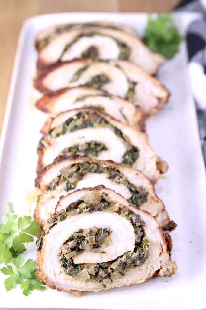 Platter with sliced, stuffed pork tenderloin