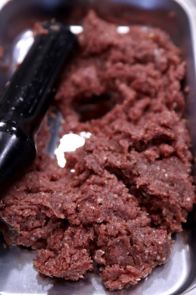 Ground venison in a sausage stuffer tray