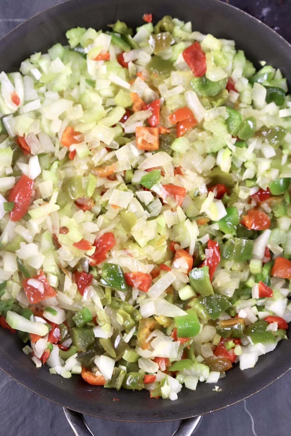 Peppers, onions, celery in a skillet
