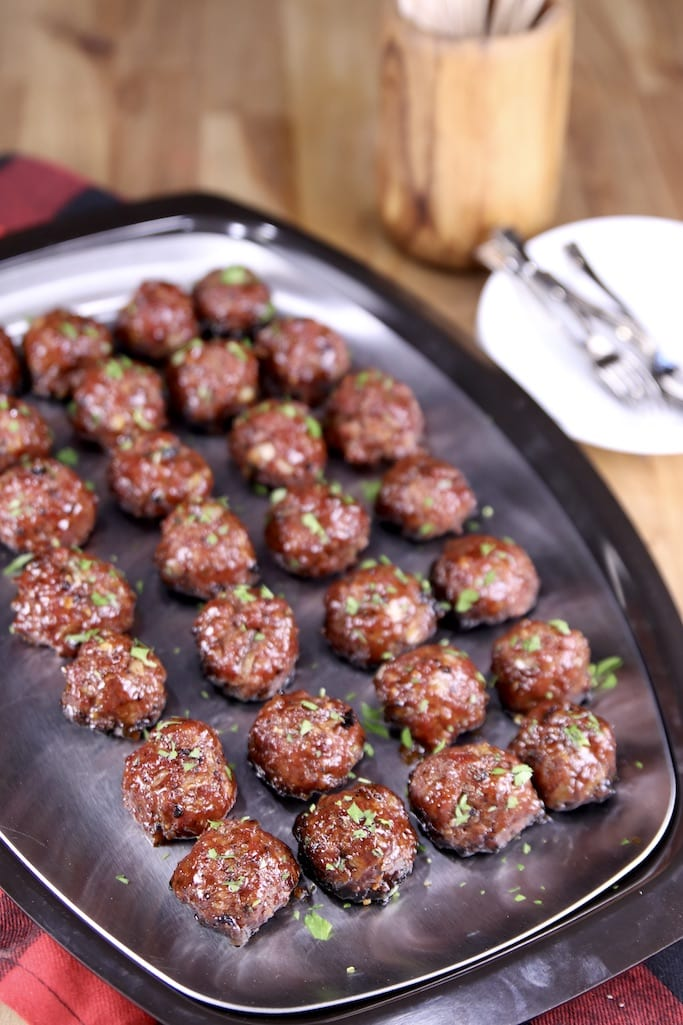 platter of peach bbq cocktail meatballs on a silver tray