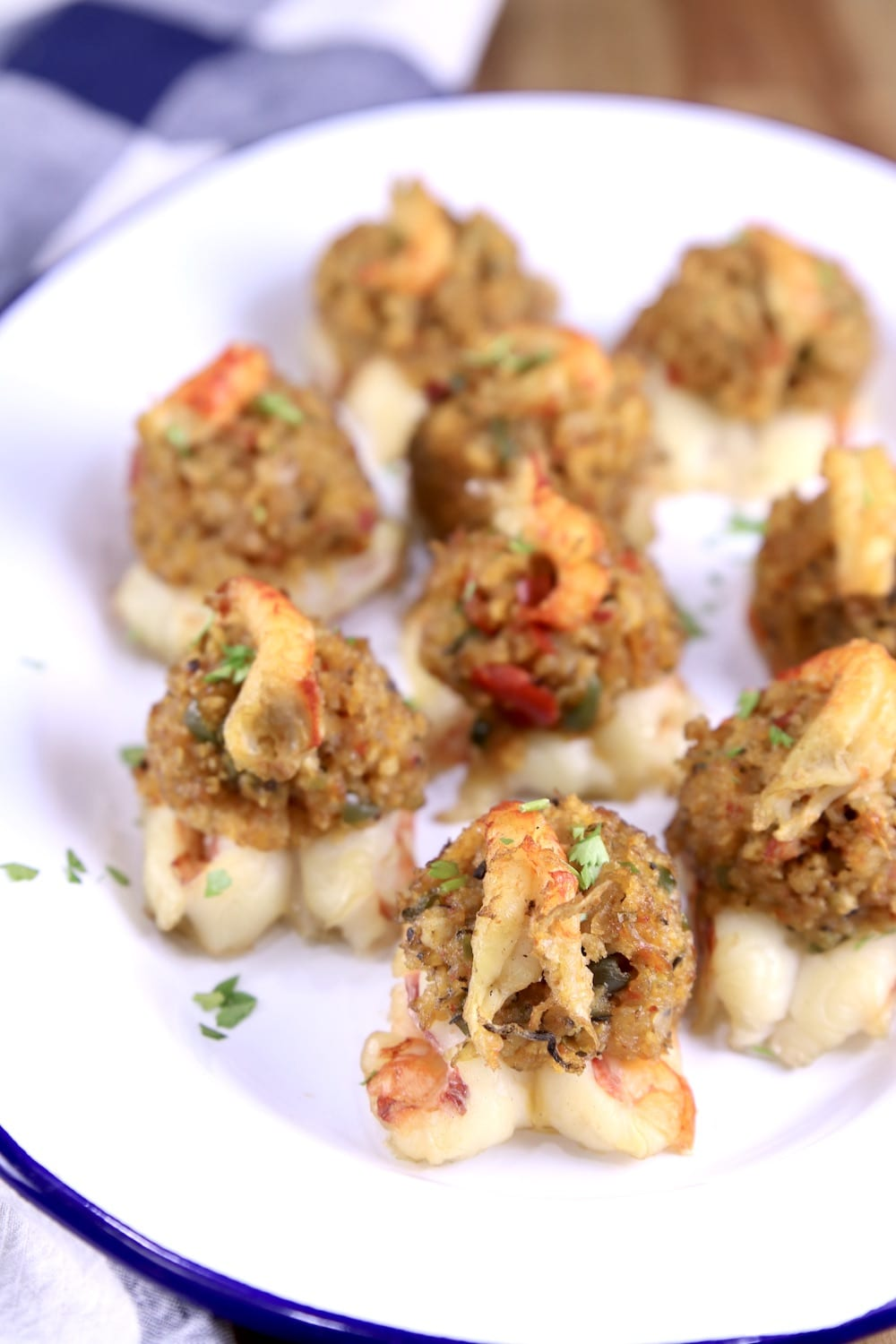 Stuffed Shrimp with crawfish stuffing on a platter, blue and white check towel in background