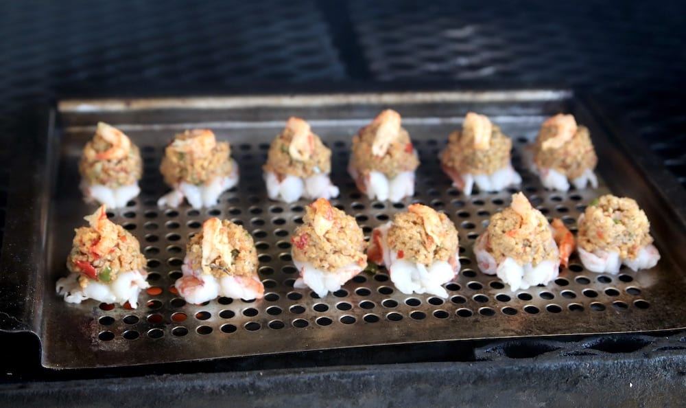 grill pan with crawfish stuffed shrimp on the grill
