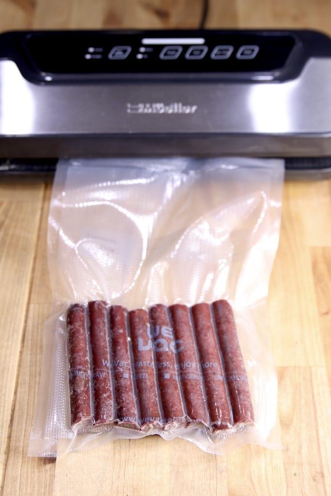 Vacuum sealer sealing bag of snack sticks