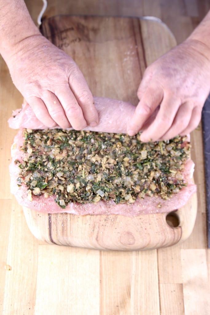 Rolling up a stuffed pork tenderloin