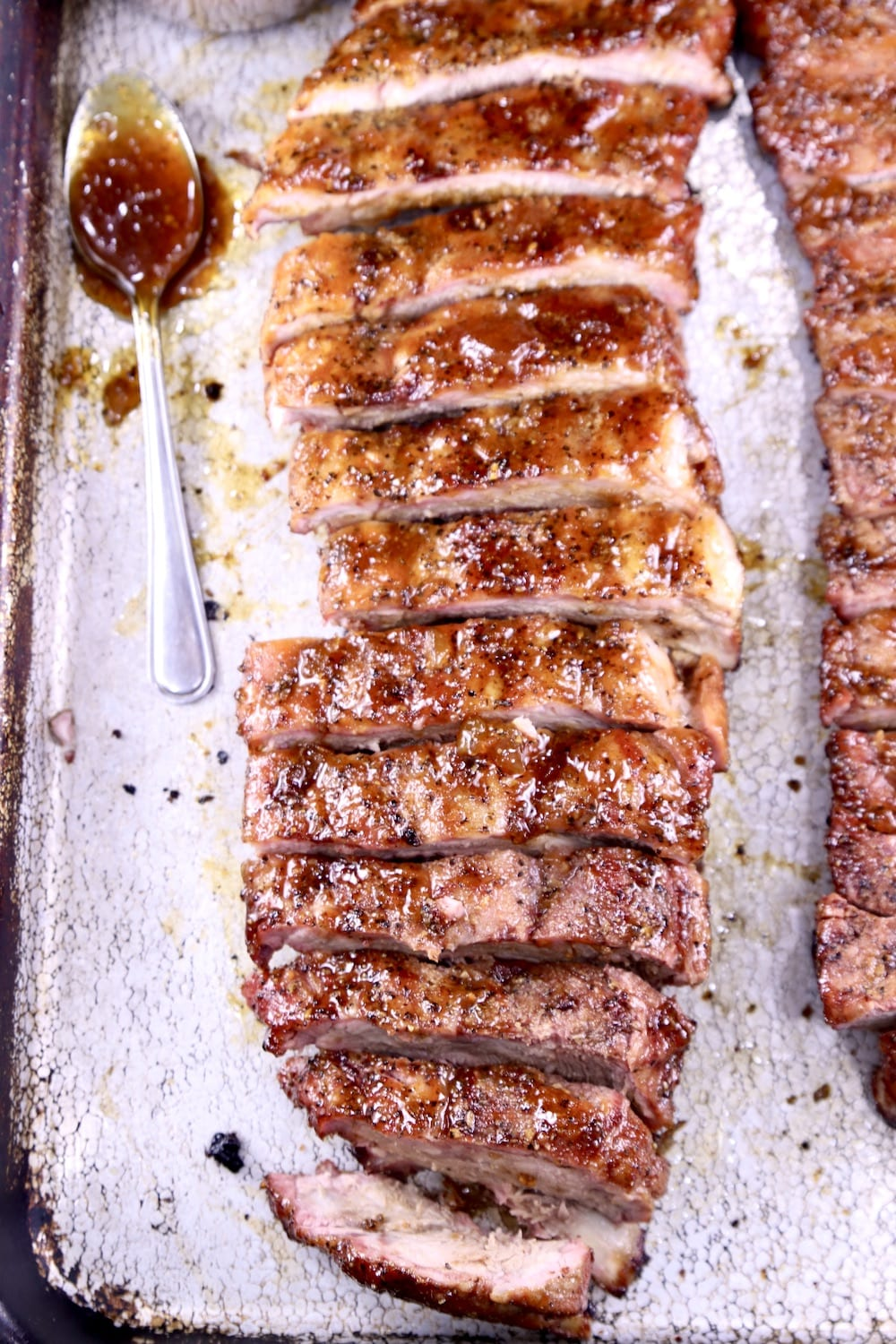 Pan with bbq ribs and spoon of sauce