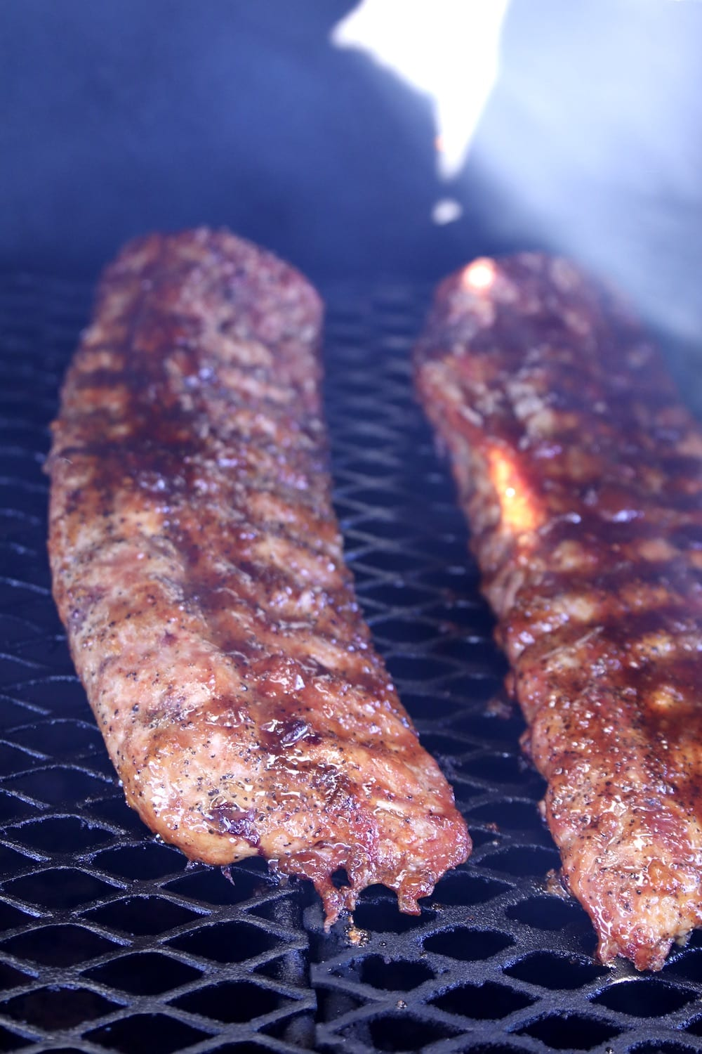 Peach BBQ Baby Back Ribs on a grill